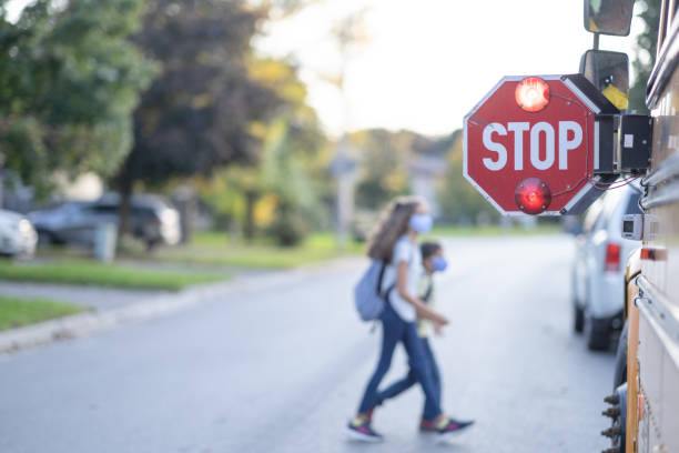 School bus stop sign for children to pass stock photo