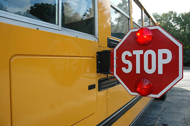 school bus stop sign - school buses stock pictures, royalty-free photos & images