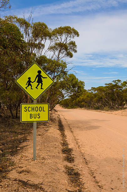 School bus stop warning road sign Australian rural outback stock photo