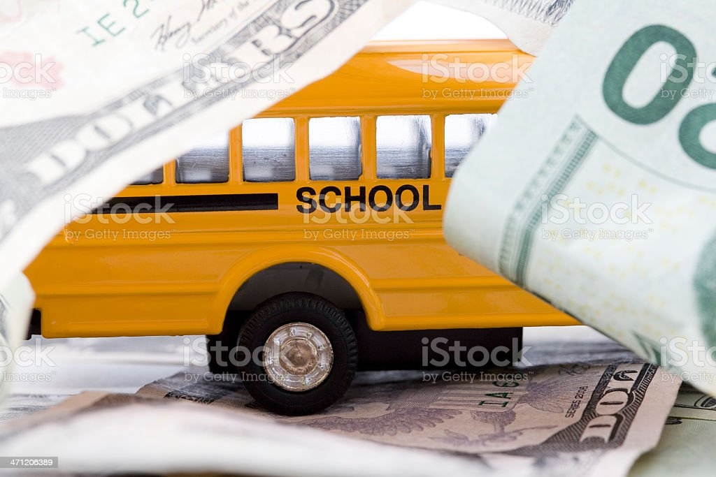 School Bus Surrounded by Money royalty-free stock photo