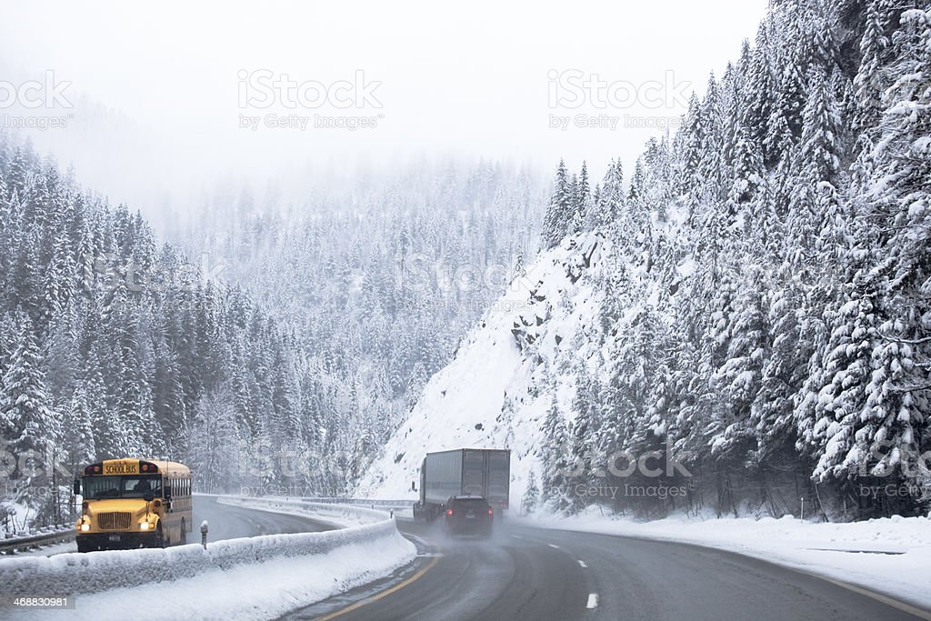 School Bus Traveling On Winter Highway Snow Weather stock photo