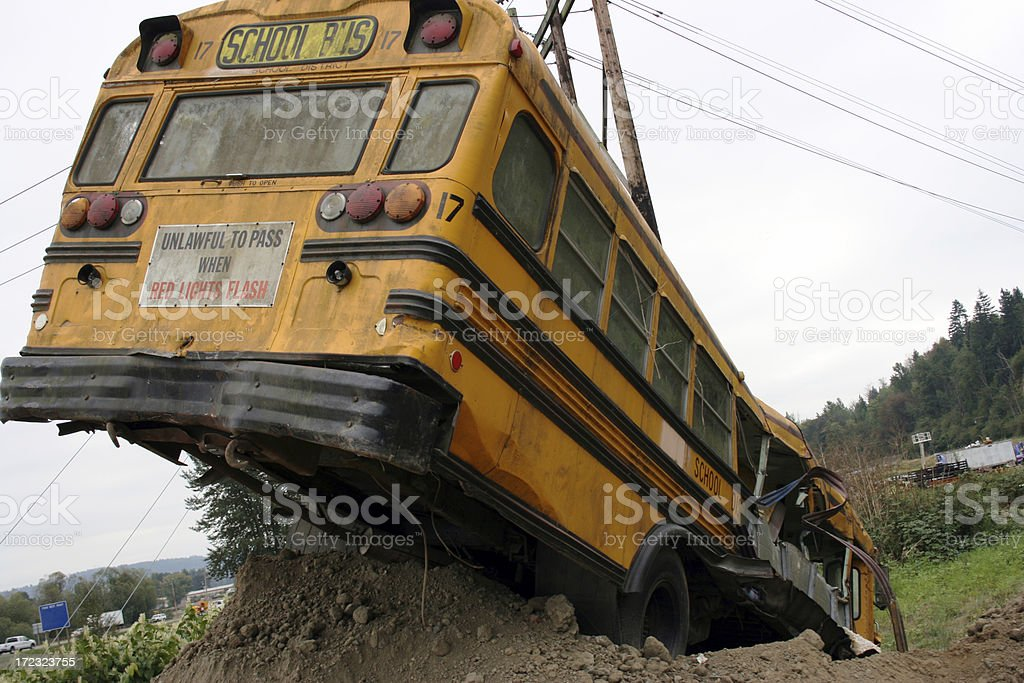 School bus wreck in ditch, rear passenger side view royalty-free stock photo