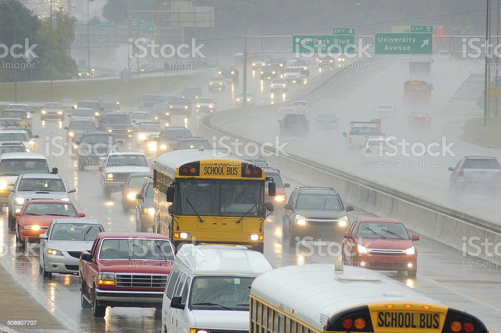 School Buses in Rush Hour Traffic on a Rainy Day stock photo