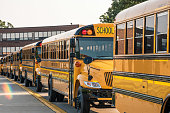 istock School buses lined up ready to pick up kids 1092429924