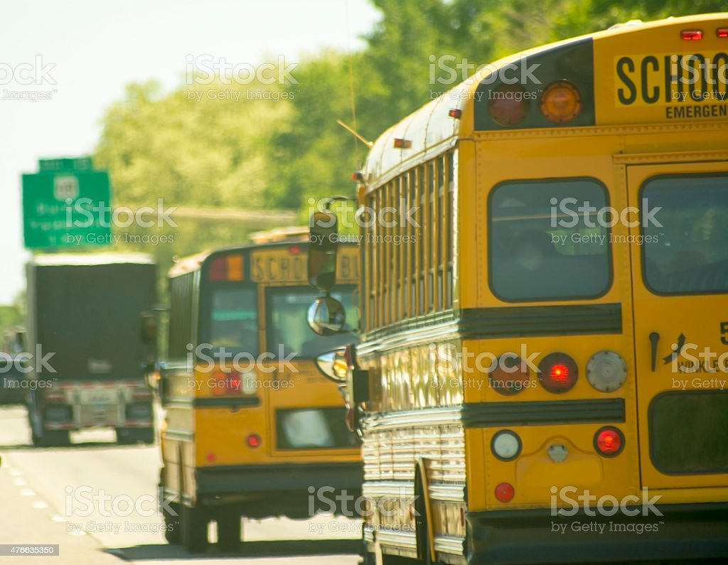 School Buses on a highway stock photo
