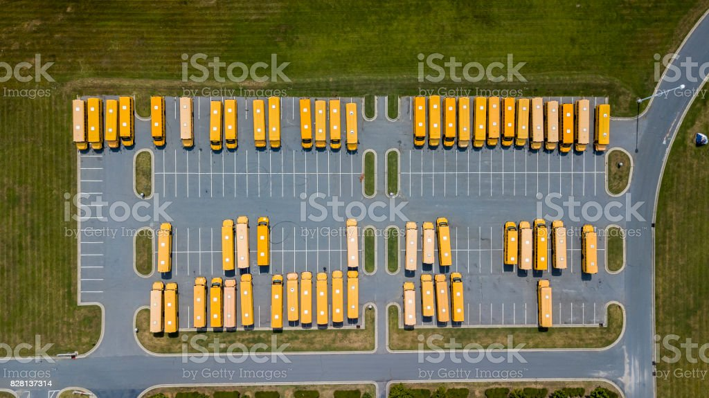 School Busses Parked At School stock photo