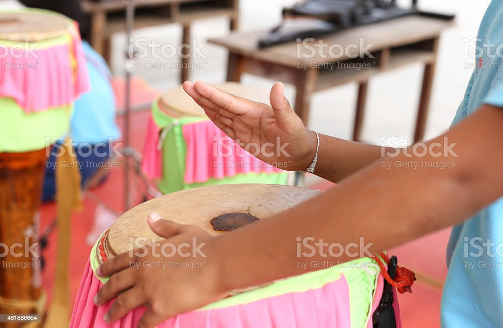 School chids hand beating on  tomtom T stock photo