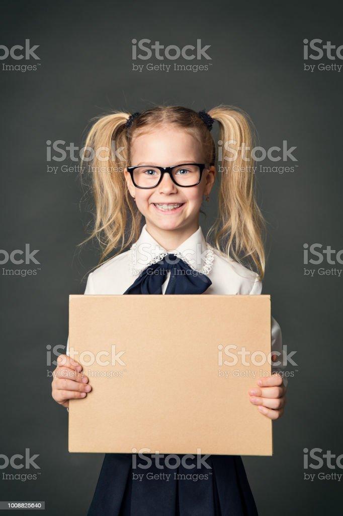 School Child Advertising Board over Blackboard Background, Girl in Glasses stock photo