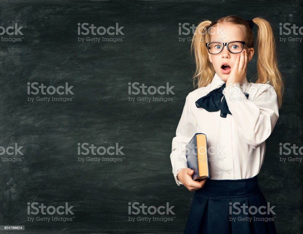 School Child Girl Amazed Face over Blackboard, Surprised Kid with Astonished Emotion stock photo
