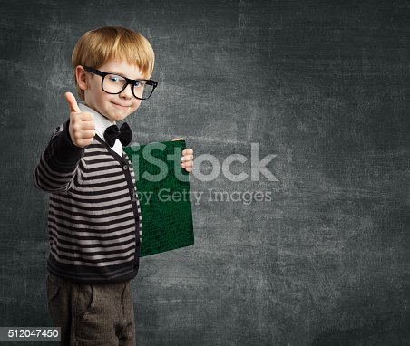 istock School Child in Glasses Thumbs Up, Kid Boy Hold Book 512047450