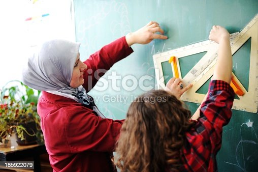 157687202 istock photo School children carrying out a classroom activity  185922079