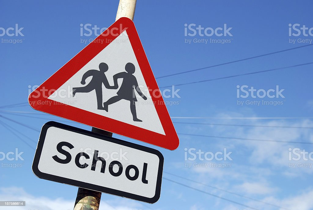 School children crossing sign with copy space stock photo