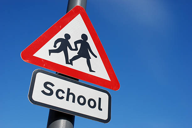 school children crossing sign with copy space - schools stock pictures, royalty-free photos & images