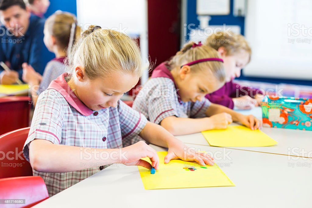 School Children Doing Drawings in the Classroom stock photo