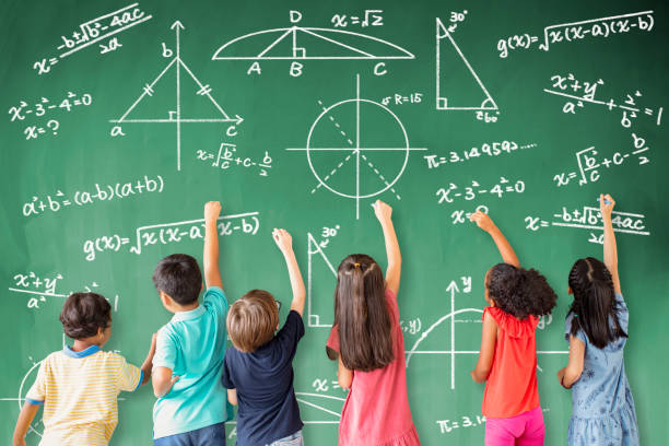 school children drawing math icon on the chalkboard school children drawing math icon on the chalkboard arithmetic stock pictures, royalty-free photos & images