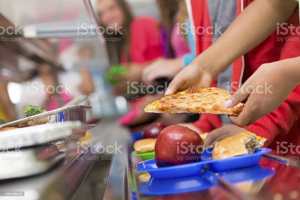 School children getting food in the cafeteria line stock photo