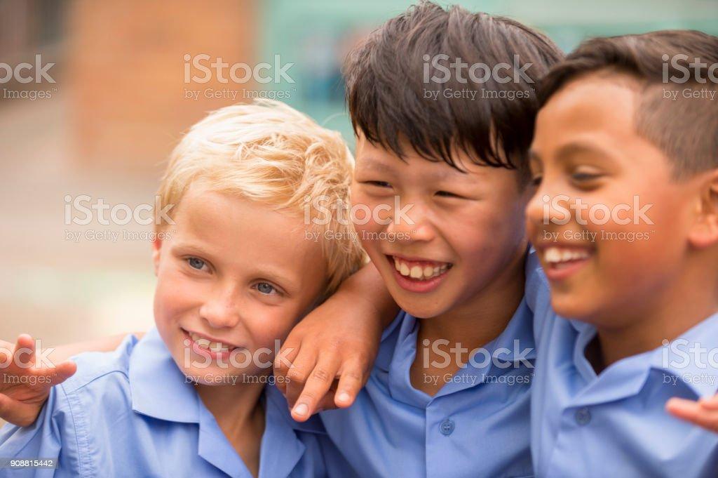 School children having fun outdoors. stock photo
