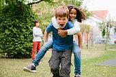 schoolyard, Piggyback, laughing, fun, primary school children,