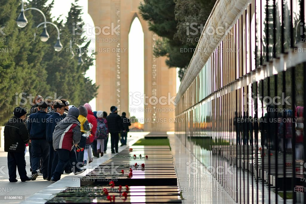 School children lay carnations at the 20th January Monument stock photo