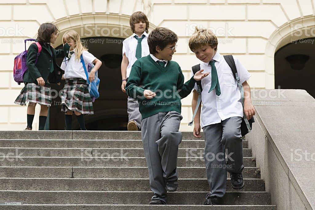 School children on steps stock photo