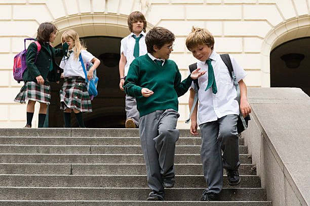 School children on steps stock photo