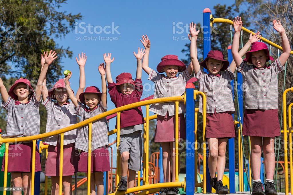 School Children Outdoors on Play Equipment stock photo