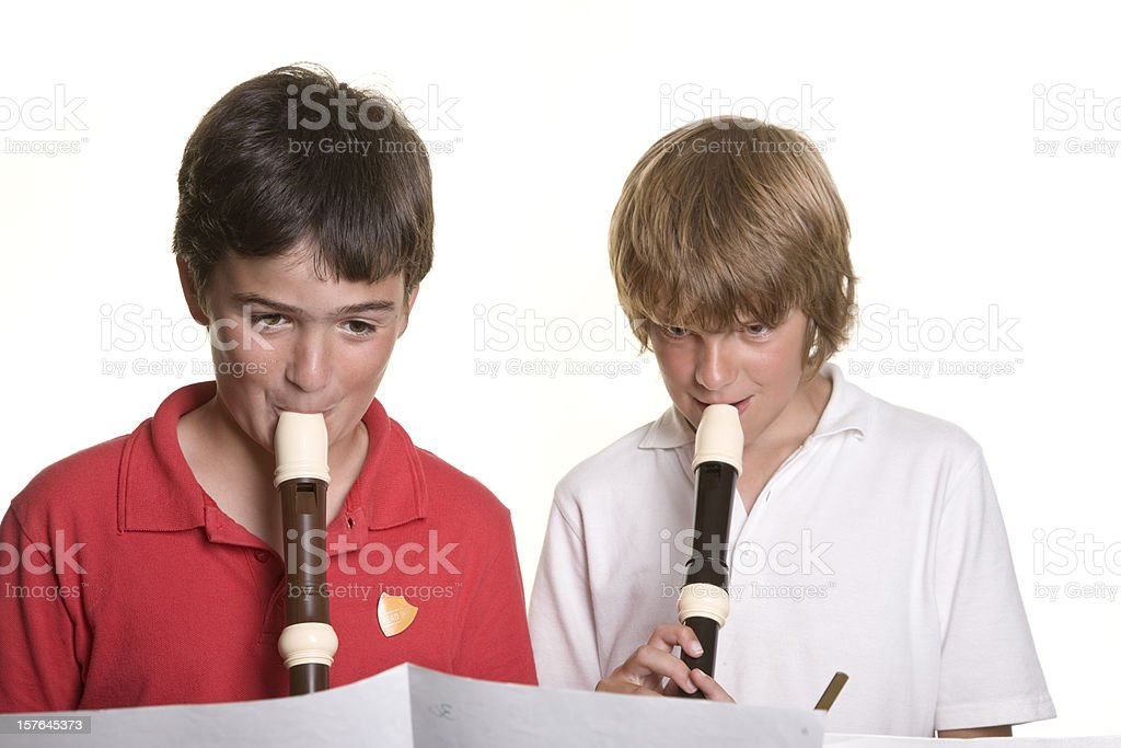 School children playing music recorders education royalty-free stock photo
