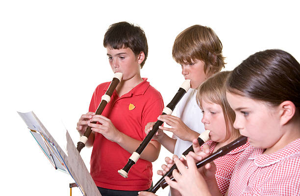 school children playing music recorders isolated education - recorder stock photos and pictures