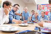 Group of school children working together on science project