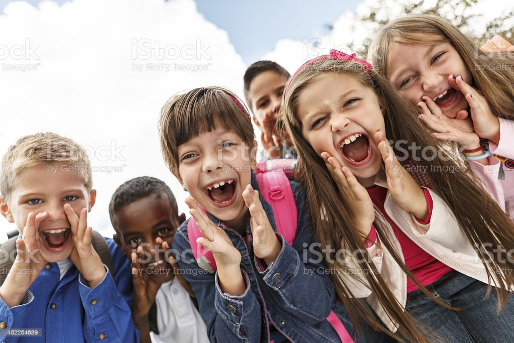 School children shouting outside stock photo