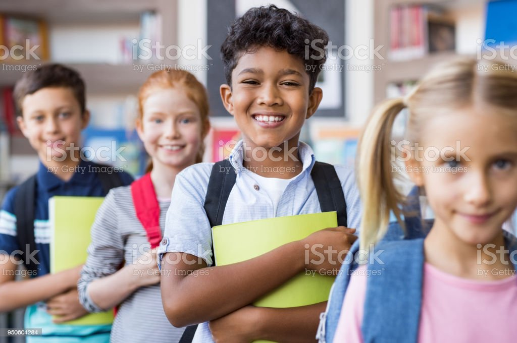 School children standing in a row stock photo