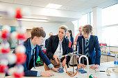A group of school children having a chemistry STEM lesson