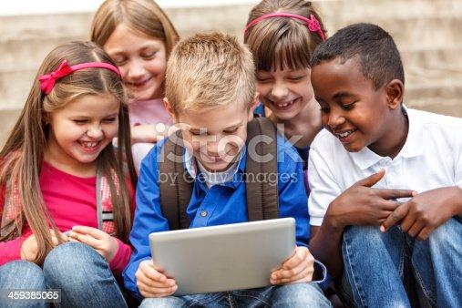 istock School children using digital tablet outside 459385065