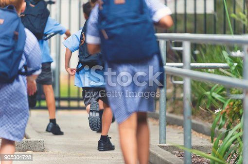 istock School children walking away. 905304728