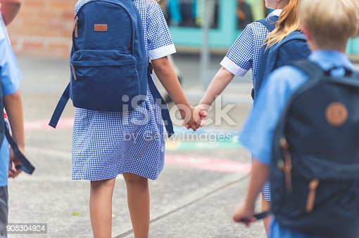 istock School children walking away. 905304924