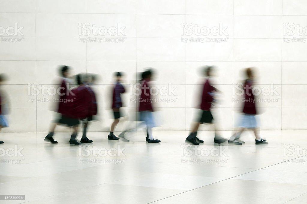 School Children Walking in Corridor, motion blur royalty-free stock photo