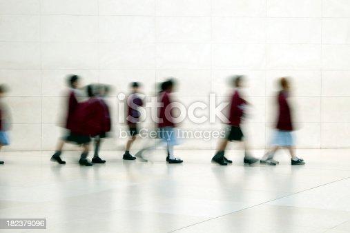 istock School Children Walking in Corridor, motion blur 182379096