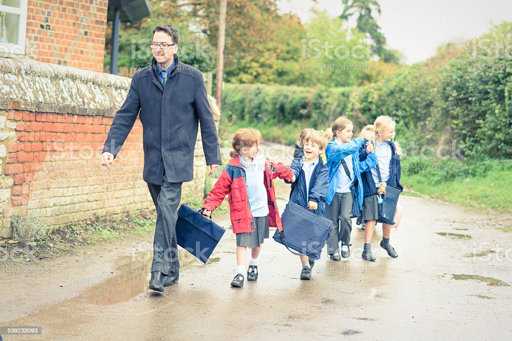 UK School children walking to meet their parents stock photo