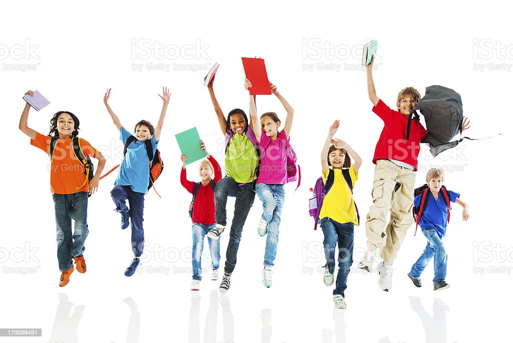 School children with backpacks and books jumping. stock photo