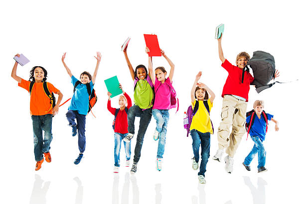 school children with backpacks and books jumping. - african youth jumping for joy stock photos and pictures