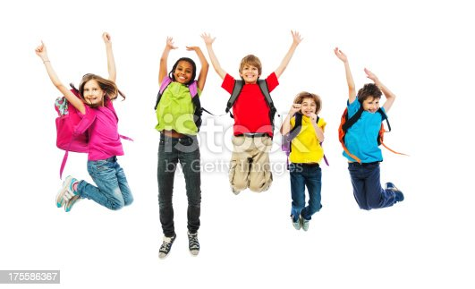 istock School children with backpacks jumping. 175586367