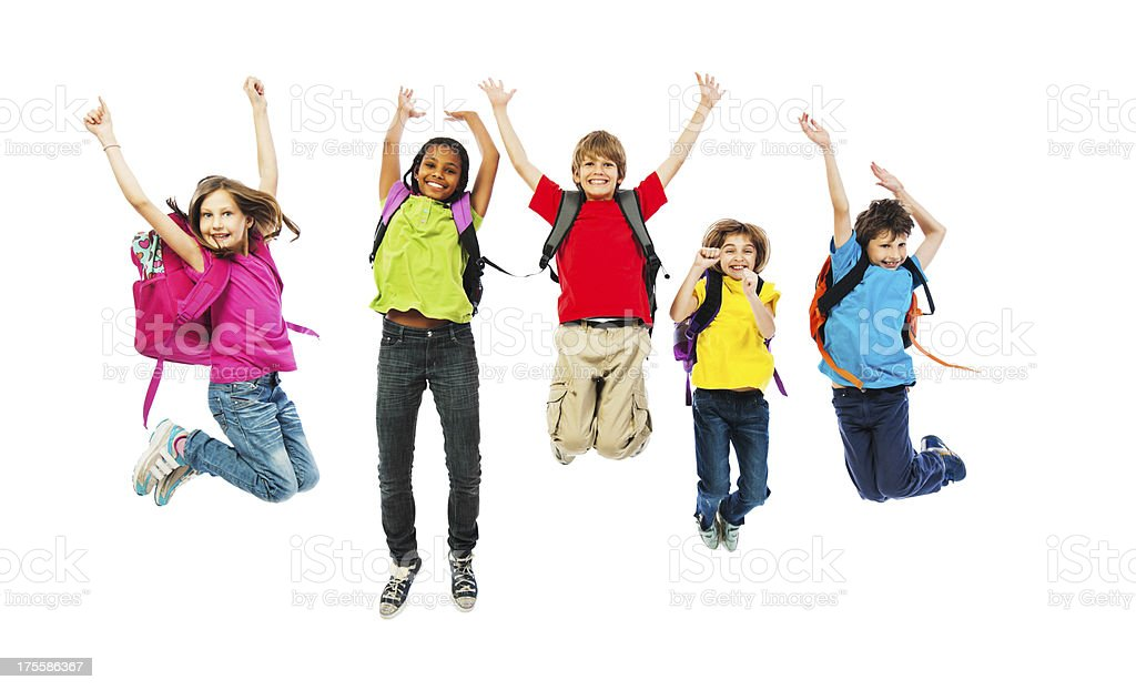 School children with backpacks jumping. stock photo