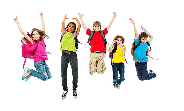 school children with backpacks jumping. - african youth jumping for joy stock photos and pictures