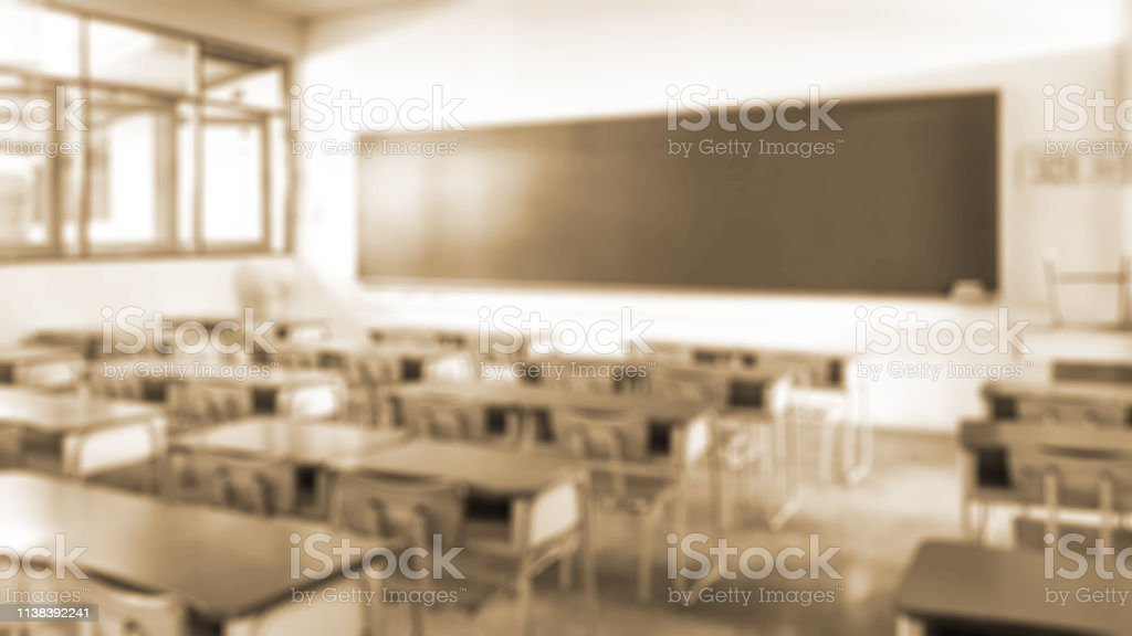 School classroom in blur background without young student; Blurry...