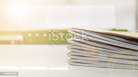 618753504 istock photo School classroom of young student in blur background with books on table. Modern empty elementary class room no kid or teacher with notebook on desk in campus. 1158557891