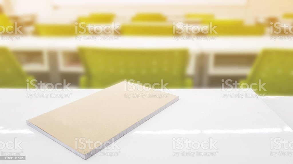 School classroom of young student in blur background with books on...