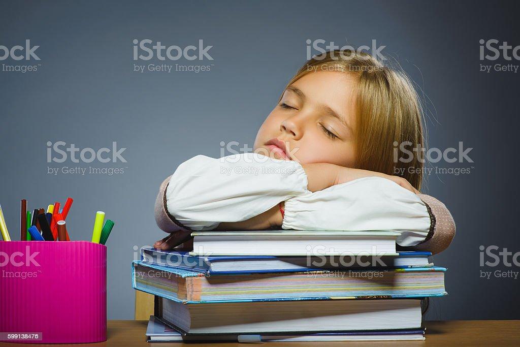 school concept. Closeup portrait girl asleep on pile of books stock photo