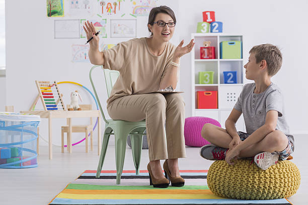 School counselor and pupil stock photo