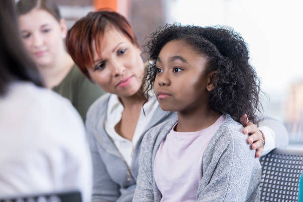 school counselor comforts student - school counselor stock photos and pictures