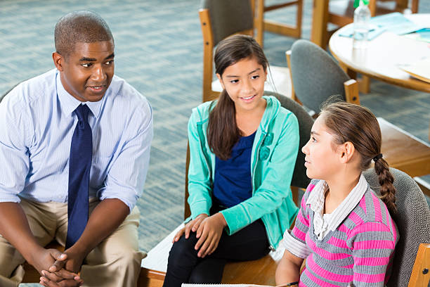 school counselor meeting with elementary students - school counselor stock pictures, royalty-free photos & images